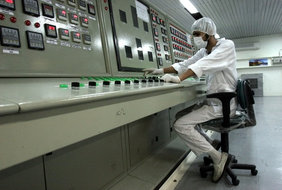 An Iranian technician works at the Uranium Conversion Facility just outside the city of Isfahan/Iran